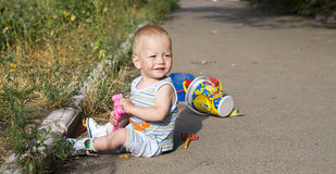 The boy playing summer outdoors Stock Image