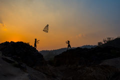 Boy playing Sunset - Together Royalty Free Stock Photography