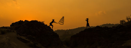 Boy playing Sunset - Together Royalty Free Stock Photo