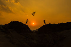 Boy playing Sunset - Together Stock Photography