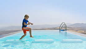 Boy Playing In  Swimming Pool Royalty Free Stock Photography