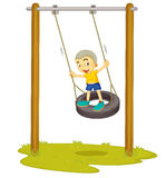 A boy playing on swing Stock Image
