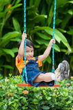 Boy playing swing Royalty Free Stock Images