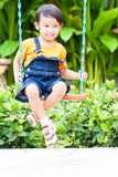 Boy playing swing Royalty Free Stock Photo