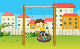 Boy playing swing Royalty Free Stock Photography