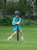 Boy playing t-ball. Boy hitting the ball off the tee Stock Image