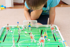 Boy playing table football Royalty Free Stock Photo