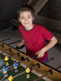 Boy playing table football Royalty Free Stock Photography