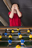 Boy playing table football Stock Photos