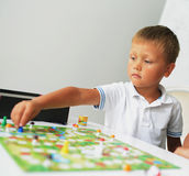 A boy playing with table game Stock Image