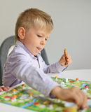 Boy playing with table game Royalty Free Stock Photo