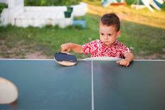 Boy playing table tennis Stock Image