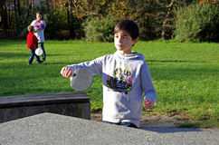 Boy playing table tennis in the park Royalty Free Stock Photos