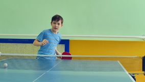 Boy playing table tennis slow motion video sport tops spin stock video