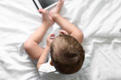 Boy playing in the tablet stock images