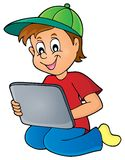 Boy playing with tablet Royalty Free Stock Photos