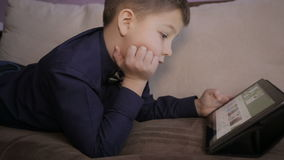 Boy playing on a tablet.Full hd video stock video