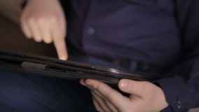 Boy playing on a tablet.Full hd video stock video footage