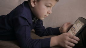 Boy playing on a tablet.Full hd video stock footage