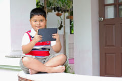 Boy playing Tablet Stock Images