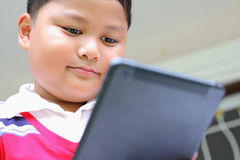 Boy playing Tablet Royalty Free Stock Photography