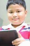 Boy playing Tablet  fun. Royalty Free Stock Image