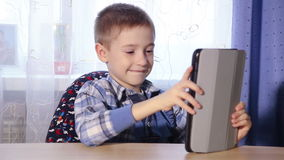 Boy playing on the tablet HD stock video footage