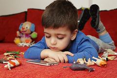 Boy playing on tablet, indoor Royalty Free Stock Photography