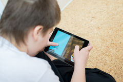 Boy playing on Tablet PC Stock Images