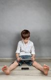 Boy playing on tablet Royalty Free Stock Image