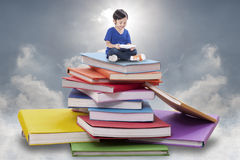 Boy playing tablet Stock Photo