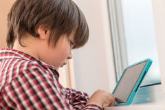 Boy playing with a tablet royalty free stock photography