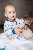 Boy playing with teddy bear. Adorable little boy playing with teddy bear toy Stock Image