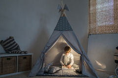 Boy playing in the teepee Royalty Free Stock Images