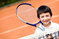 Boy playing tennis Stock Images