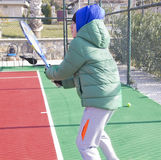 Boy is playing tennis. The boy is playing tennis Stock Photo