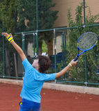 Boy is playing tennis. In the tennis court Stock Photography