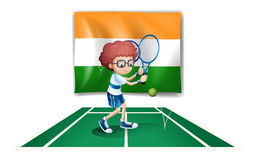 A boy playing tennis in front of the Ireland flag Stock Photo