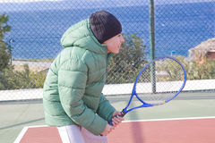 The  Boy is Playing Tennis Stock Photography