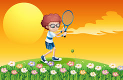 A boy playing tennis at the hill Stock Photo