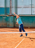 Boy playing tennis. Little boy playing tennis outdoors on the tennis field on a sunny day Stock Photography