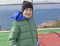 The boy is playing tennis. At the sea Stock Photos