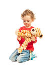 Boy playing with tiger toy Stock Photos