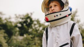 Boy playing to be an astronaut royalty free stock images