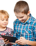 Children playing with a tablet computer Stock Photography