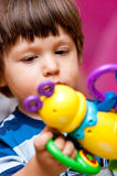 Boy playing with toy Royalty Free Stock Photo