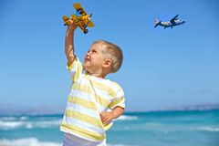 Boy playing with a toy airplane Stock Images