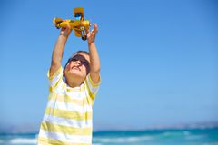 Boy playing with a toy airplane Royalty Free Stock Images