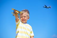 Boy playing with a toy airplane Royalty Free Stock Photos