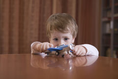 Boy Playing With Toy Airplane Royalty Free Stock Photography